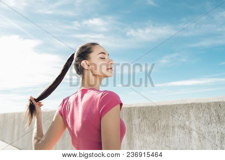 A Peaceful Young Girl Resting After Training In The Open Air, Gaining Strength And Energy
