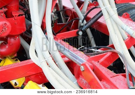 Springs And Tubes Are Arranged In A Row. A Row Of Seeder. Heavy Equipment On Agricultural Exhibition
