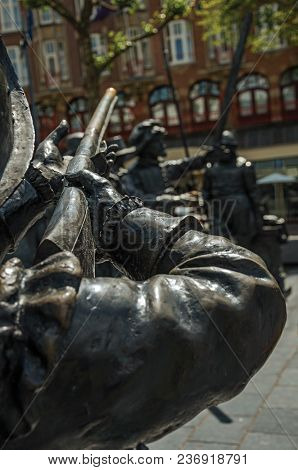 Bronze Sculpture Of Xvii Century Soldier On The Rembrandt Square In A Sunny Day At Amsterdam. The Ci