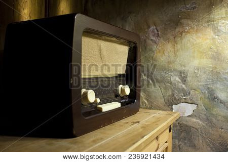 An Old Radio On The Background Of An Old Wall With Cracks