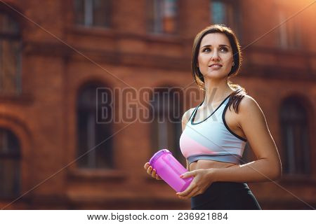 Young Attractive Sports Woman Drinking Sport Supplements After Running, Working Out Or Exercising Ou