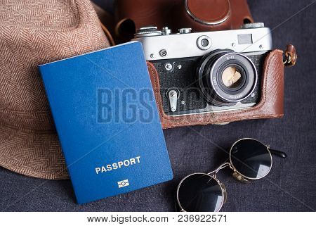 Travel Passport On Gray Background. Sunglasses, Hat. Vintage Camera On The Background. Eu Visa Free