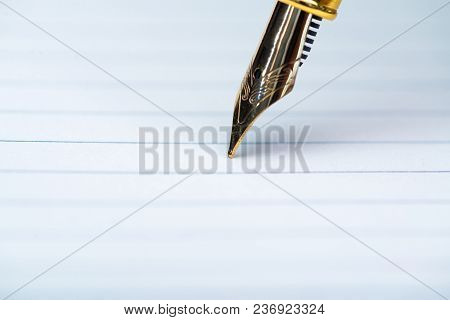 Close Up Of Fountain Pen Or Ink Pen With Notebook Paper On Wooden Working Table With Copy Space, Off