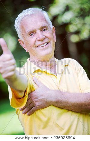 Portrait of smiling elderly man outdoor in park