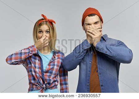 Young Cheerful Couple Hipsters, Young People Pinch Your Fingers On Your Nose From The Unpleasant Sme