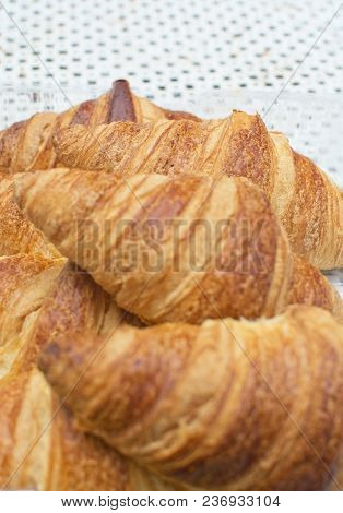 Fresh Croissant Breads Closeup On Rustic Table Top