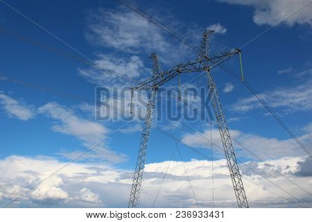 The Power Transmission Lines (power Lines) On The Sky Background