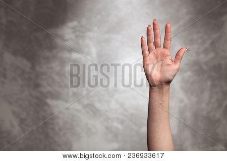 Female hand on dark background