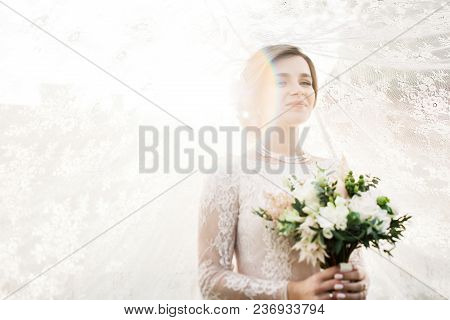 Bride With Wedding Makeup And Hairstyle. Smiling Bride.