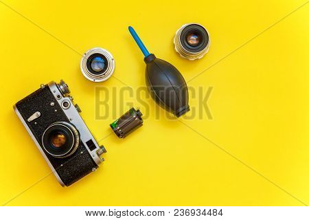 Vintage Film Photo Camera Lens Film Roll And Accessories On Yellow Colourful Trendy Modern Fashion P