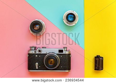 Vintage Film Photo Camera Lens Film Roll And Accessories On Yellow, Pink And Blue Colourful Pastel T