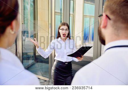 Business Lady Screams At Subordinates. Conversation On High Tones. Showdown