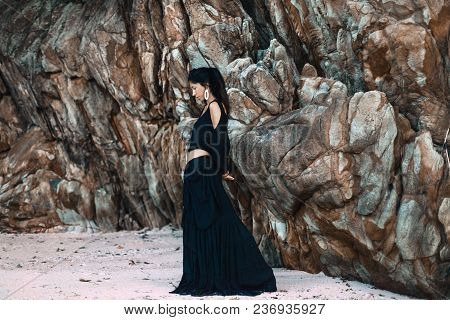 Boho Style Young Woman In Elegant Black Dress Outdoors