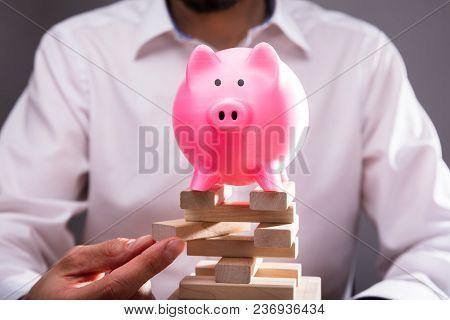 Businessperson's Hand Arranging Wooden Blocks