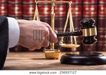 Judge Striking Mallet On Sounding Block