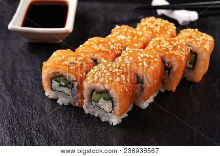 Philadelphia Maki Sushi On Black Background And Souce