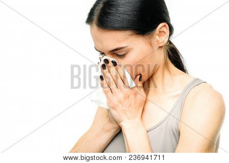Painful woman with runny nose, snot or flu, white background. Female person in lingerie, medical advertising or concept