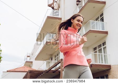 Happy Active Young Girl Running Outdoors, Loves Sports And Training