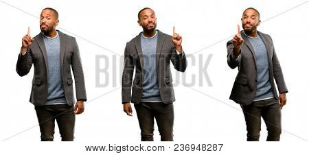 African american man with beard raising finger, the number one
