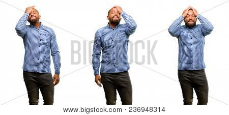 African american man with beard stressful keeping hand on head, tired and frustrated