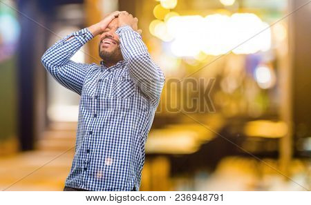 African american man with beard stressful keeping hands on head, tired and frustrated at night