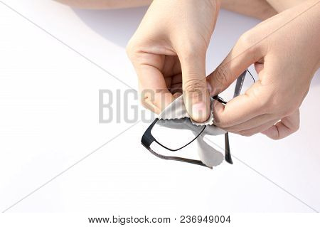 Hand Woman With A Napkin Wipes Glasses On A White Background.