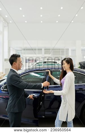 Pretty Young Vietnamese Woman Taking Keys Of Her New Car