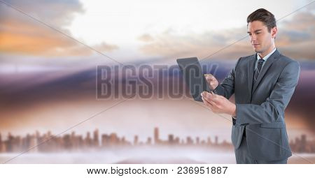 businessman with tablet in cityscape