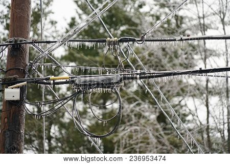 Icicle On Power Line In The Frozen Rain