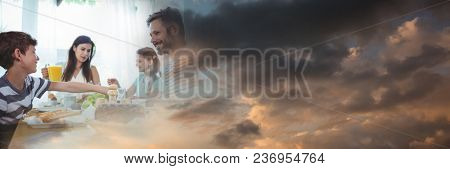 Family at dinner table with evening sky transition