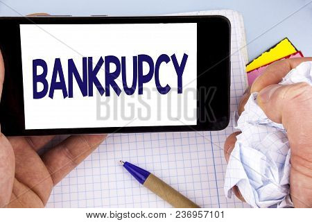 Handwriting Text Writing Bankrupcy. Concept Meaning Company Under Financial Crisis Goes Bankrupt Wit