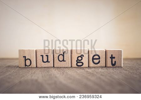 The Word Budget, Text On Wooden Cubes On Table Top. Background Copy Space, Vintage Minimal Style. Co