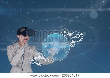 Happy woman in VR headset touching interface against blue background with flares