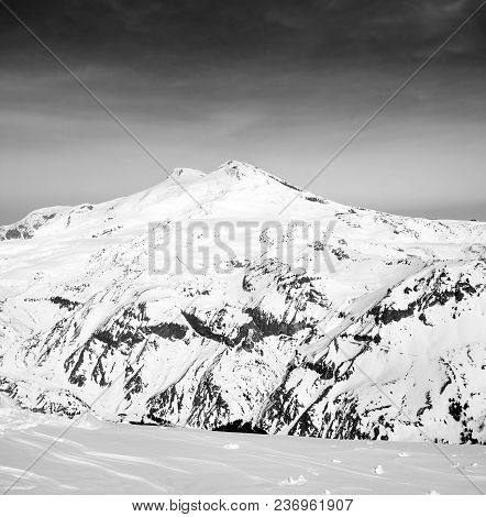 Black And White Panoramic View On Snowy Mount Elbrus. View From Mt. Cheget. Caucasus Mountains In Wi