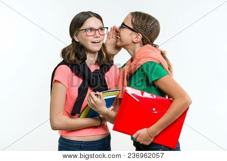 Happy High School Friends Are Teenage Girls, Talk And Secret. White Background, With Books And Noteb