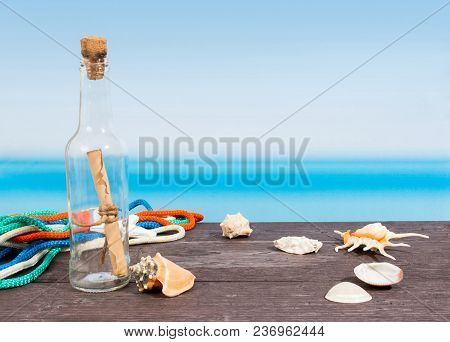 Tropical Sea Seen From The Boat. Message In Bottle On Table