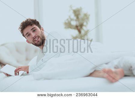 closeup.awakened man typing with a digital tablet