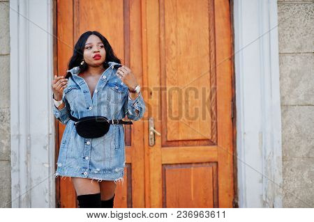African American Girl In Jeans Dress Posed On Streets Of City. Black Stylish Model Shoot.