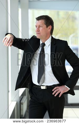 portrait of confident businessman on blurred background