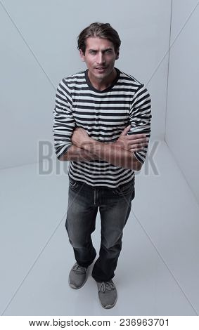 modern man standing in the corner of the white room .