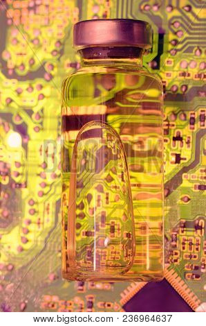 Vial With Liquid On Circuit Board. Abstract Technology Background.