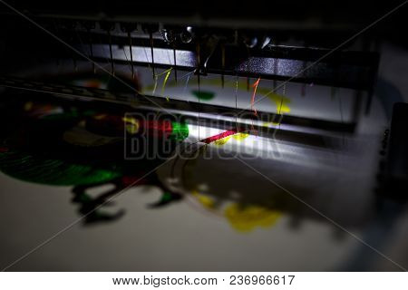 An Automatic Sewing Machine Sews With Colored Threads And Precision In Making Any Shape Or Design. C
