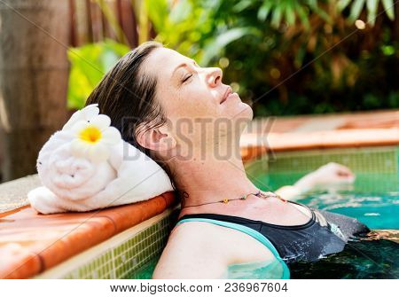 Woman enjoying the water in a swimming pool