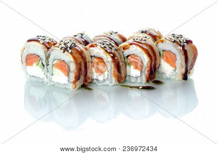 On White Isolated Background With Reflection, Sushi Rolls With Eel And Uramaki Salmon Emperor