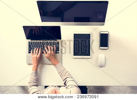 People working at the table with digital device