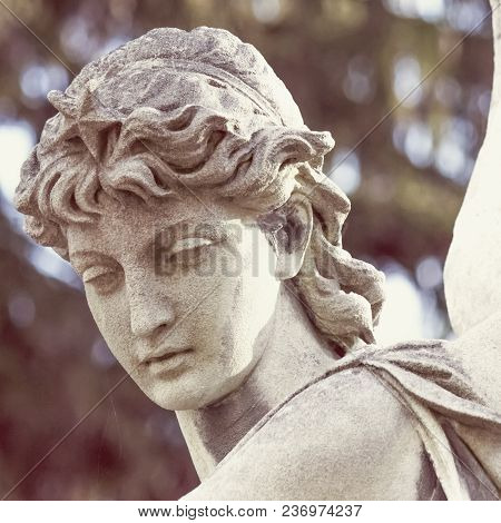 Figure Of Angel As A Symbol Of Love, Kindness, And Suffering. Fragment Of Ancient Statue. Retro Styl