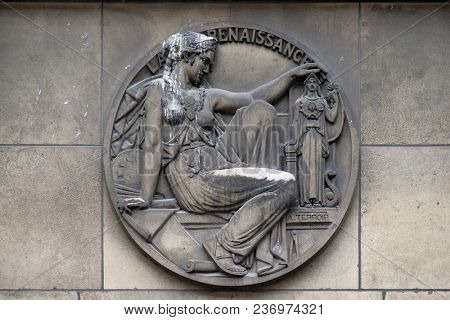 PARIS, FRANCE - JANUARY 11: Stone relief with the Renaissance symbol at the building of the Faculte de Medicine Paris, France on January 11, 2018.
