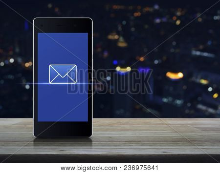 Email Icon On Modern Smart Phone Screen On Wooden Table Over Blur Colorful Night Light City Tower, B