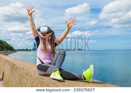 Young Woman Testing Vr Eyeglasses Outside. Female Wearing Virtual Reality Headset During Summer Weat