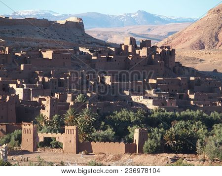 Kasbah Ait Ben Haddou Or Benhaddou Fortified City And Green Exotic Palm Trees At Oasis On African At